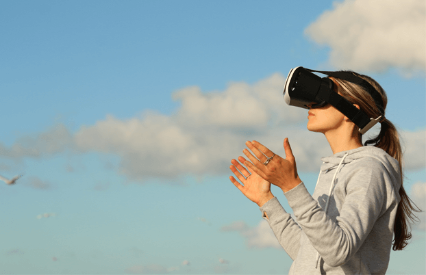 woman experiencing VR outside