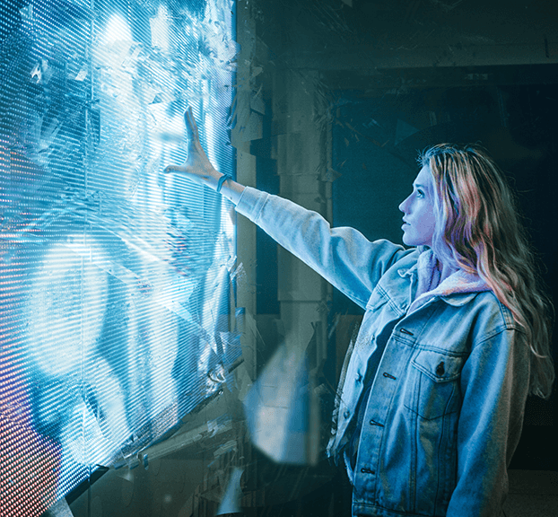 woman experiencing an interactive touch screen.